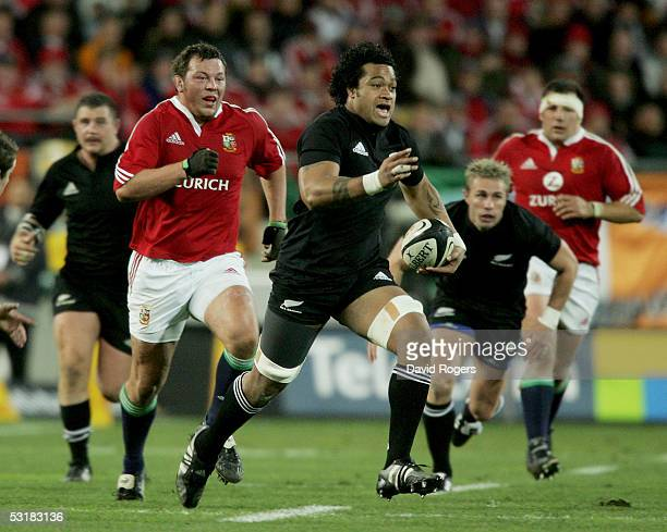 Sione Lauaki the All Black replacement races away from Steve Thompson during the second test match between The New Zealand All Blacks and the British...