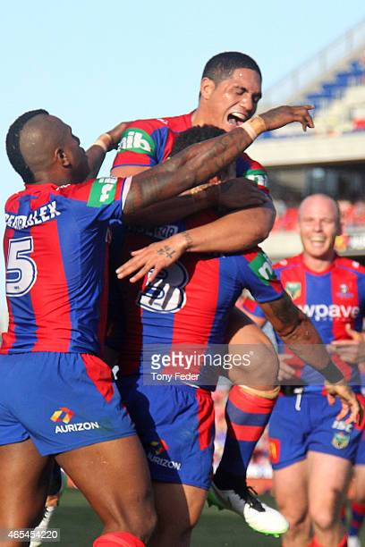Sione Mata'Utia and Dane Gagai of the Knights celebrate a try during the round one NRL match between the Newcastle Knights and the New Zealand...