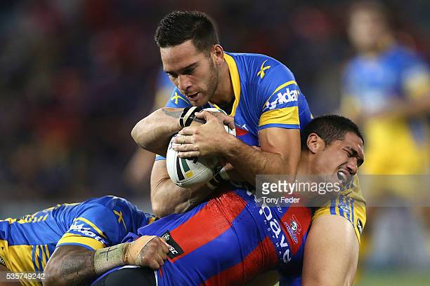 Sione Mata'Utia of the Knights is tackled by the Eels defence during the round 12 NRL match between the Newcastle Knights and the Parramatta Eels at...