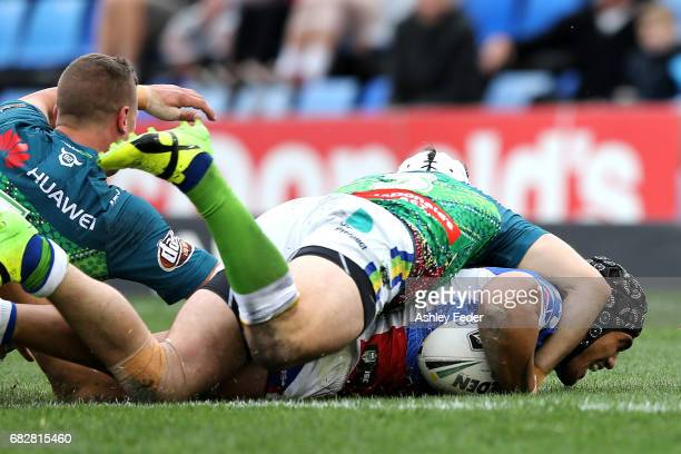 Sione Mata'Utia of the Knights scores a try during the round 10 NRL match between the Newcastle Knights and the Canberra Raiders at McDonald Jones...