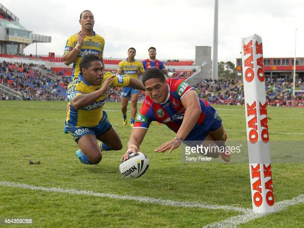 Sione Mata'Utia of the Knights scores a try during the round 25 NRL match between the Newcastle Knights and the Parramatta Eels at Hunter Stadium on...