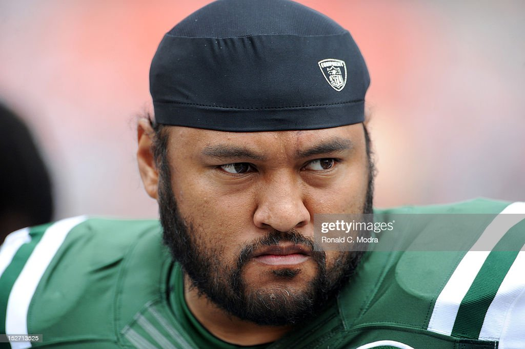 <b>Sione Pouha</b> #91 of the New York Jets looks on during a NFL game against - sione-pouha-of-the-new-york-jets-looks-on-during-a-nfl-game-against-picture-id152713525