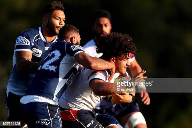 Sione Tuipulotu of Melbourne Rising is tackled during the round five NRC match between Queensland Country and Melbourne at Bond University on...
