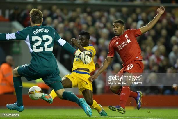 FC Sion's Ebenezer Assifuah scores past Liverpool's Jordan Ibe and goalkeeper Simon Mignolet