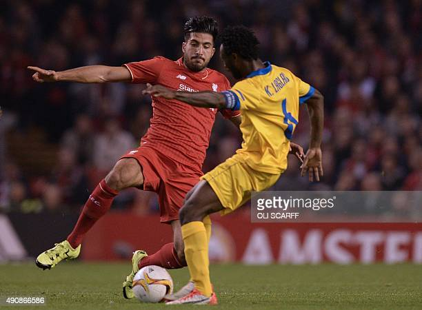 Sion's Ivorian midfielder Xavier Kouassi vies with Liverpool's German midfielder Emre Can during the UEFA Europa League group B football match...