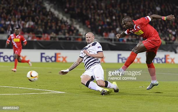 Sion's Senegalese forward Moussa Konate shoots despite Bordeaux's French defender Nicolas Pallois during the UEFA Europa League group B football...