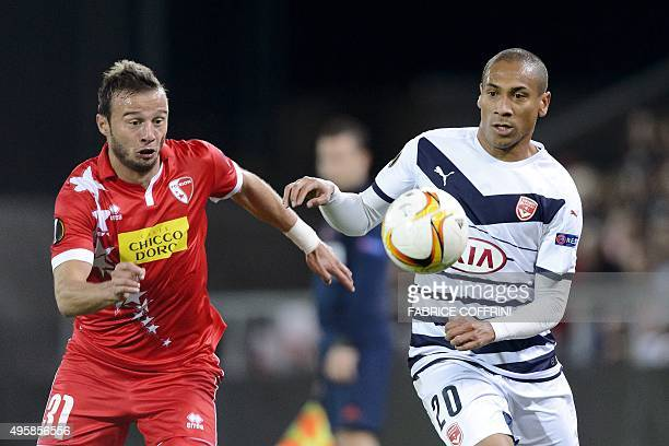 Sion's Swiss defender Elsad Zverotic and Bordeaux's Brazilian forward Ferreira Jussie vie during the UEFA Europa League group B football match...