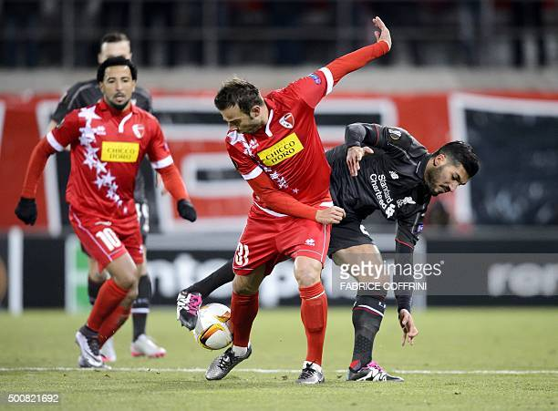 TOPSHOT Sion's Swiss defender Elsad Zverotic and Liverpool's German midfielder Emre Can vies for the ball during the UEFA Europa League group B...