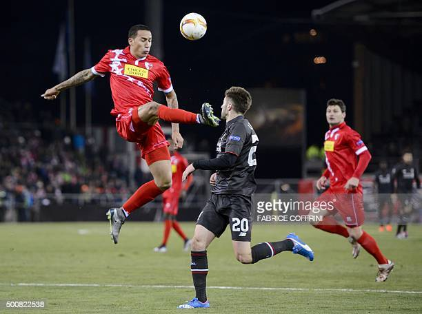 Sion's Swiss defender Leo Lacroix and Liverpool's English midfielder Adam Lallana vie for the ball during the UEFA Europa League group B football...