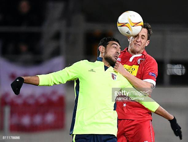Sion's Swiss defender Reto Ziegler heads the ball next to Braga's Egyptian forward Ahmed Hassan during the UEFA Europa League round of 32 first leg...