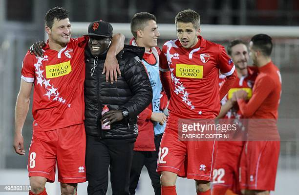 Sion's Swiss midfielder Veroljub Salatic who scored the team's goal reacts with teammates at the end of the UEFA Europa League group B football match...