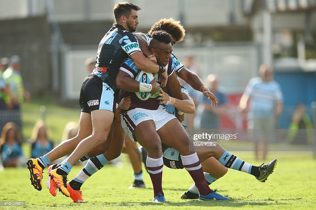 Siosaia Vave of the Eagles is tackled during the NRL Trial match between the Cronulla Sharks and the Manly Sea Eagles at Remondis Stadium on February 14, 2016 in Sydney, Australia.