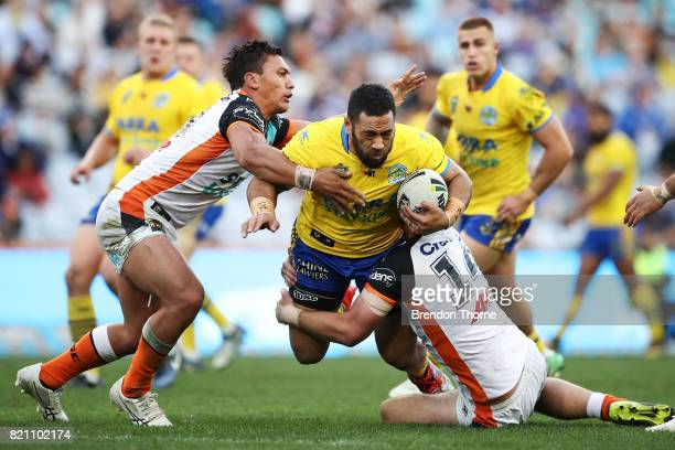 Siosaia Vave of the Eels is tackled by the Tigers defence during the round 20 NRL match between the Wests Tigers and the Parramatta Eels at ANZ...