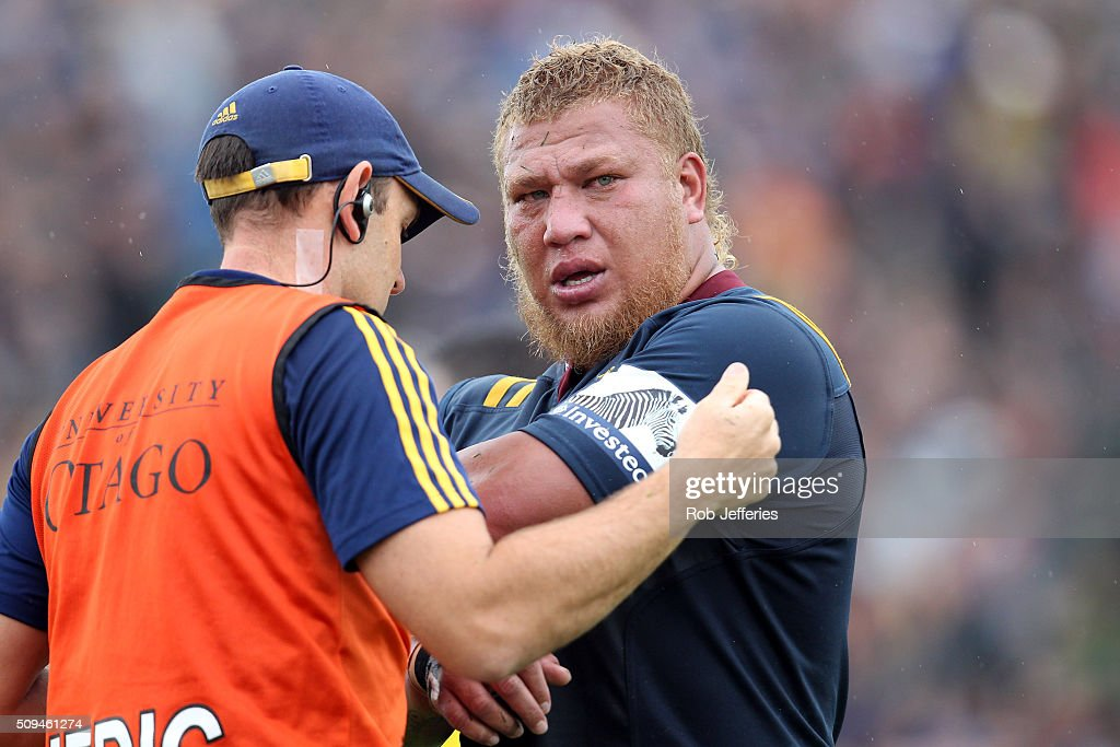Siosiua Halanukonuka of the Highlanders is treated by medical staff during the Super Rugby trial match between the Highlanders and the Crusaders at Fred Booth Park on February 11, 2016 in Waimumu, New Zealand.