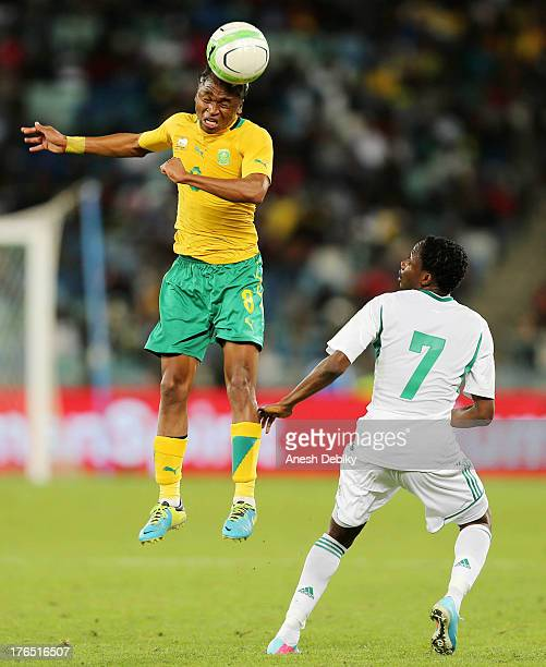 Siphiwe Tshabala of South Africa heads the ball past Ahmed Musa of Nigeria during the 2013 Nelson Mandela Challenge match between South Africa and...