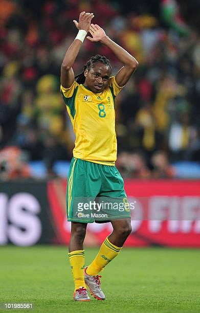 Siphiwe Tshabalala of South Africa applauds the fans after the 2010 FIFA World Cup South Africa Group A match between South Africa and Mexico at...