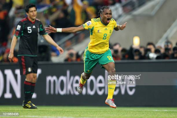 Siphiwe Tshabalala of South Africa celebrates after scoring the opening goal while Ricardo Osorio of Mexico looks dejected during the 2010 FIFA World...
