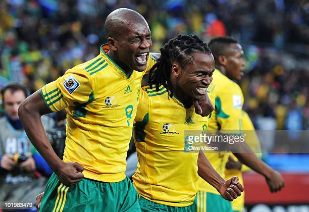 Siphiwe Tshabalala of South Africa celebrates scoring the first goal with team mate Katlego Mphela during the 2010 FIFA World Cup South Africa Group...