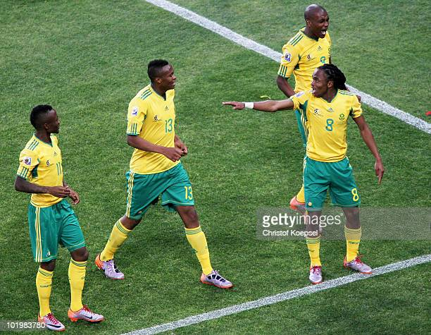 Siphiwe Tshabalala of South Africa celebrates scoring the first goal with team mates during the 2010 FIFA World Cup South Africa Group A match...
