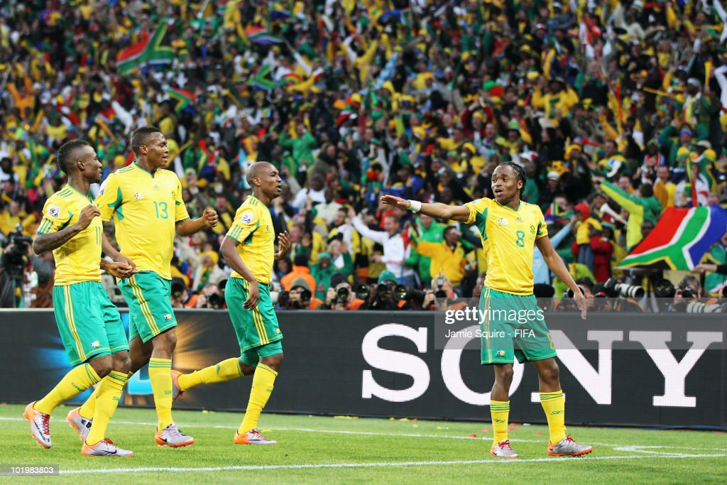 Siphiwe Tshabalala (R) of South Africa celebrates scoring the first goal with team mates during the 2010 FIFA World Cup South Africa Group A match between South Africa and Mexico at Soccer City Stadium on June 11, 2010 in Johannesburg, South Africa.