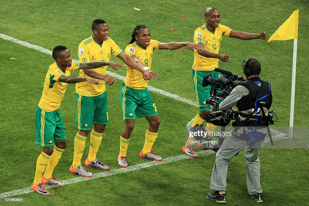 <a gi-track='captionPersonalityLinkClicked' href=/galleries/search?phrase=Siphiwe+Tshabalala&family=editorial&specificpeople=788347 ng-click='$event.stopPropagation()'>Siphiwe Tshabalala</a> (C) of South Africa celebrates scoring the first goal with team mates during the 2010 FIFA World Cup South Africa Group A match between South Africa and Mexico at Soccer City Stadium on June 11, 2010 in Johannesburg, South Africa.