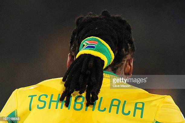 Siphiwe Tshabalala of South Africa holds his dreadlocks together in a hairband during the 2010 FIFA World Cup South Africa Group A match between...