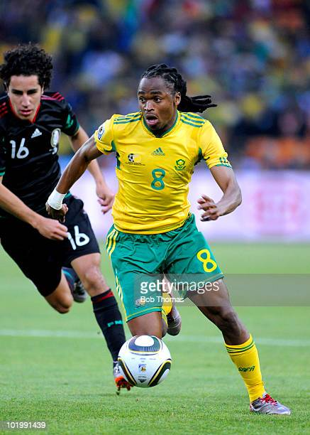 Siphiwe Tshabalala of South Africa is chased by Efrain Juarez of Mexico during the 2010 FIFA World Cup South Africa Group A match between South...