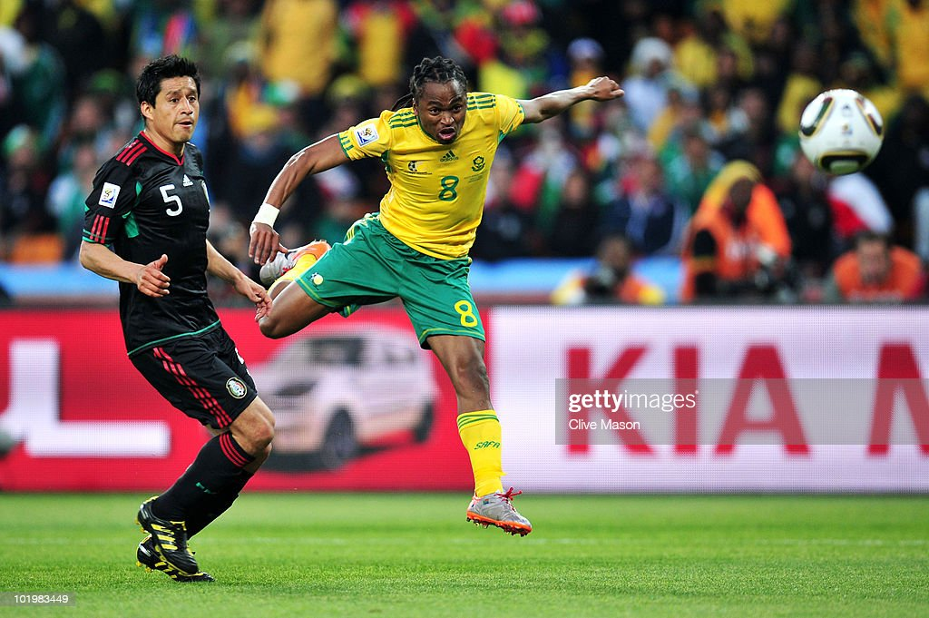 <a gi-track='captionPersonalityLinkClicked' href=/galleries/search?phrase=Siphiwe+Tshabalala&family=editorial&specificpeople=788347 ng-click='$event.stopPropagation()'>Siphiwe Tshabalala</a> of South Africa scores the first goal during the 2010 FIFA World Cup South Africa Group A match between South Africa and Mexico at Soccer City Stadium on June 11, 2010 in Johannesburg, South Africa.