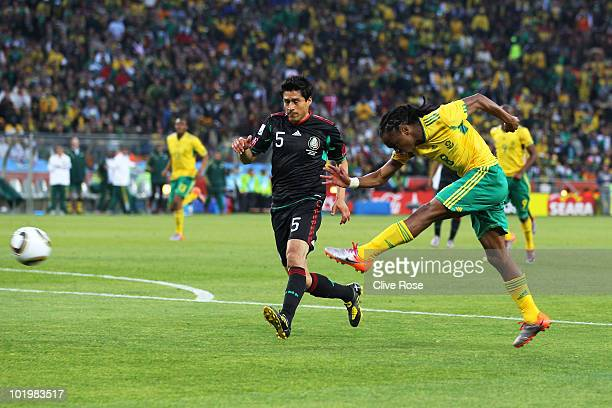 Siphiwe Tshabalala of South Africa scores the first goal during the 2010 FIFA World Cup South Africa Group A match between South Africa and Mexico at...