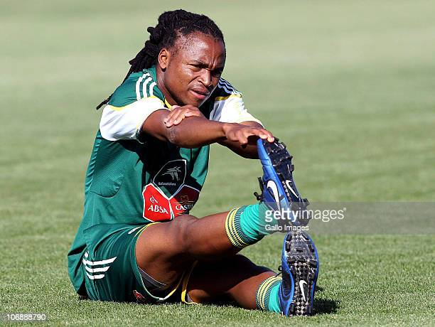 Siphiwe Tshabalala of South Africa stretches during a South Africa team training session ahead of the Nelson Mandela Challenge Cup match against the...