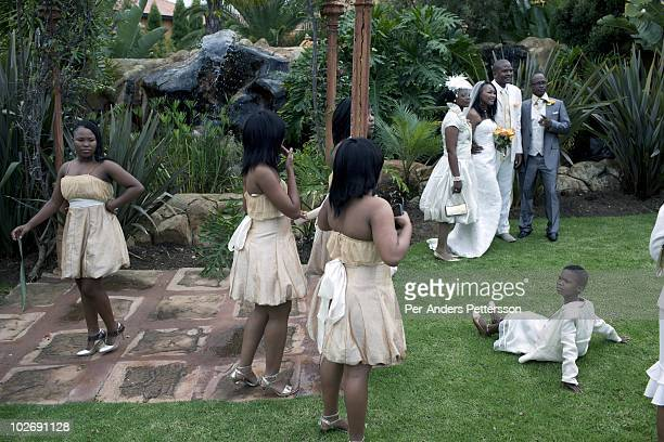 Siphokazi Cola age 26 and Xolile Ngambane age 28 dance as they celebrate their wedding day at the Tuscan Wedding village on May 1 in Johannesburg...