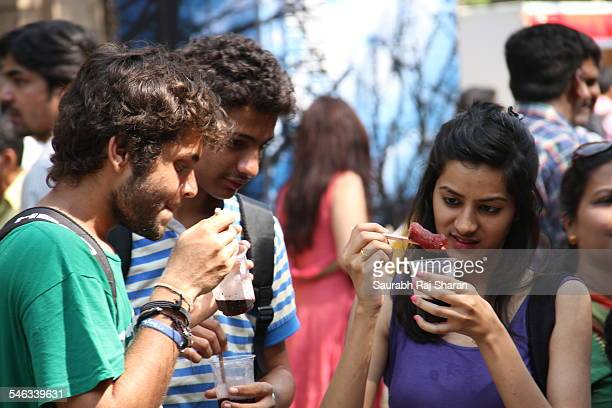 Sipping on ice gola at mumbai