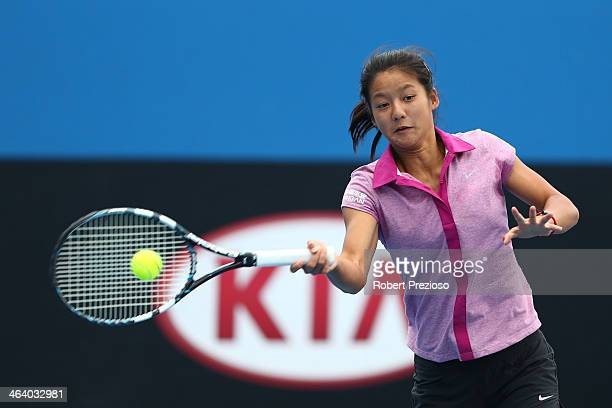 Siqi Cao and Wushuang Zheng of China celebrate in their junior girls doubles match against Annabelle Andrinopoulos and Katerina Valos of Australia...