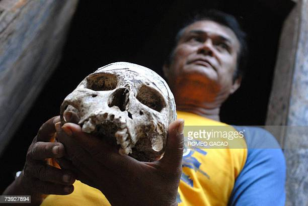 TO GO WITH STORY PHILIPPINESMAGICWITCHCRAFTSORCERER by Karl Wilson Filipino sorcerer Alberto 'Edol' Baroro holds a human skull he uses for his black...