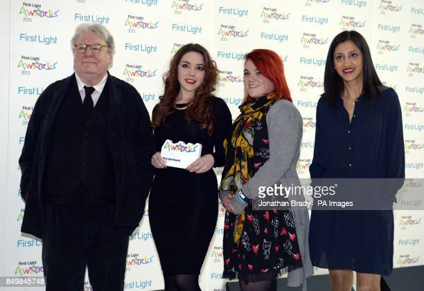 Sir Alan Parker and Manjinder Virk stand beside Rachel Welsh and Keira Georgeson from Swindon with the Best Film by Over 13s award at the First Light...