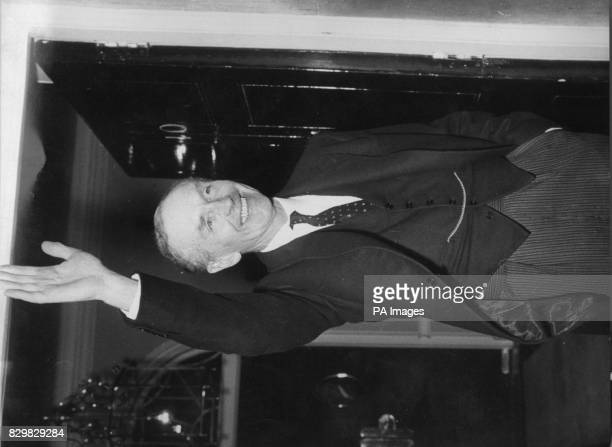 Sir Alec DouglasHome the Prime Minister who earlier had visited the Queen at Buckingham Palace stands on hand in his pocket and waves to the bank of...
