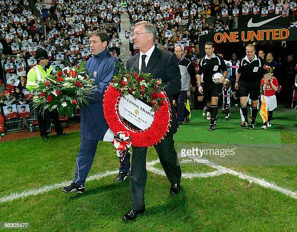 Sir Alex Ferguson and Bryan Robson lead their teams out carrying wreaths paying tribute to George Best ahead of the Carling Cup match between...