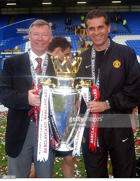 Sir Alex Ferguson and Carlos Queiroz celebrate with the Premier League Trophy after the FA Barclaycard Premiership match between Everton v Manchester...