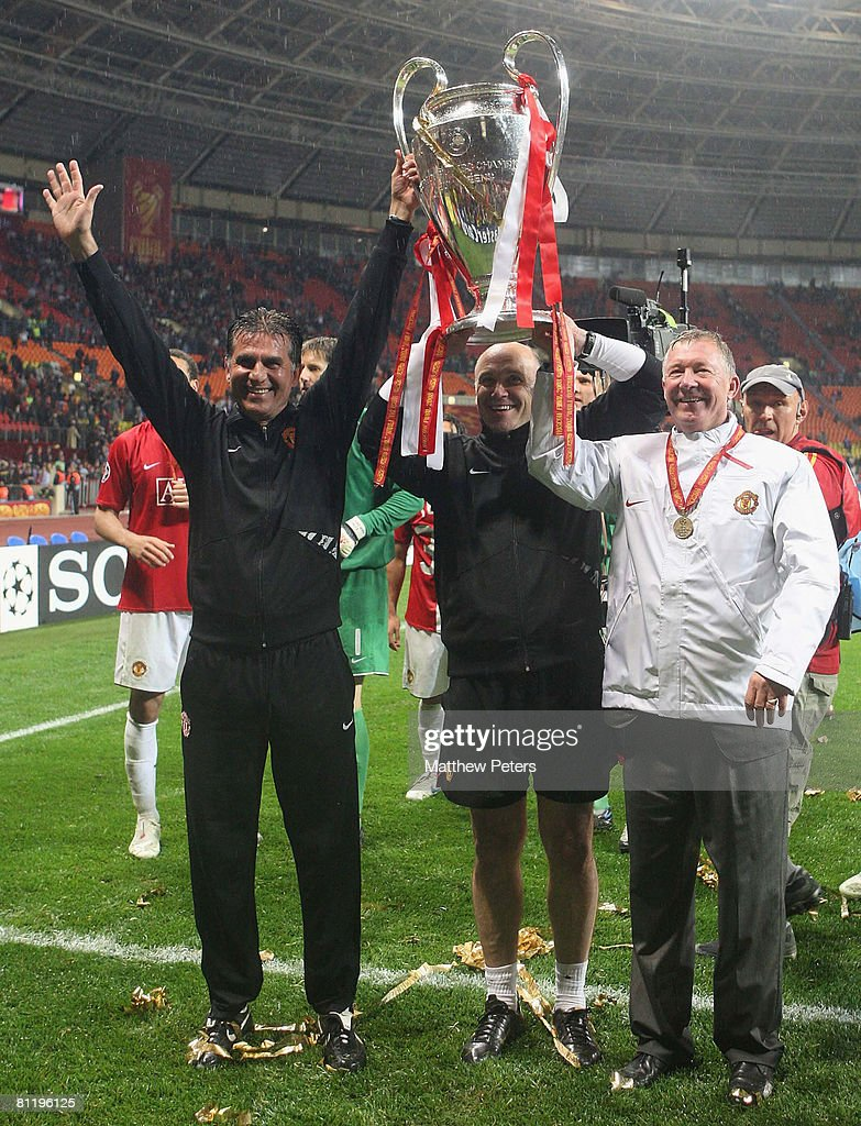 Sir Alex Ferguson and Carlos Queiroz of Manchester United celebrates with the trophy after winning the UEFA Champions League Final match between Manchester United and Chelsea at Luzhniki Stadium on May 21 2008 in Moscow, Russia.