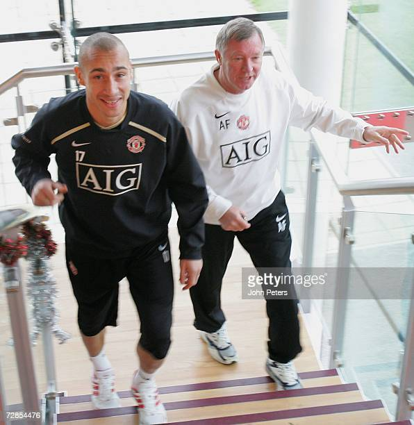Sir Alex Ferguson and Henrik Larsson of Manchester United attend a press conference at Carrington Training Ground on December 20 in Manchester England
