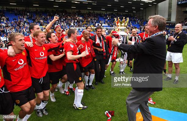 Sir Alex Ferguson and his team with the Premiership Trophy after the FA Barclaycard Premiership match between Everton v Manchester United at Goodison...