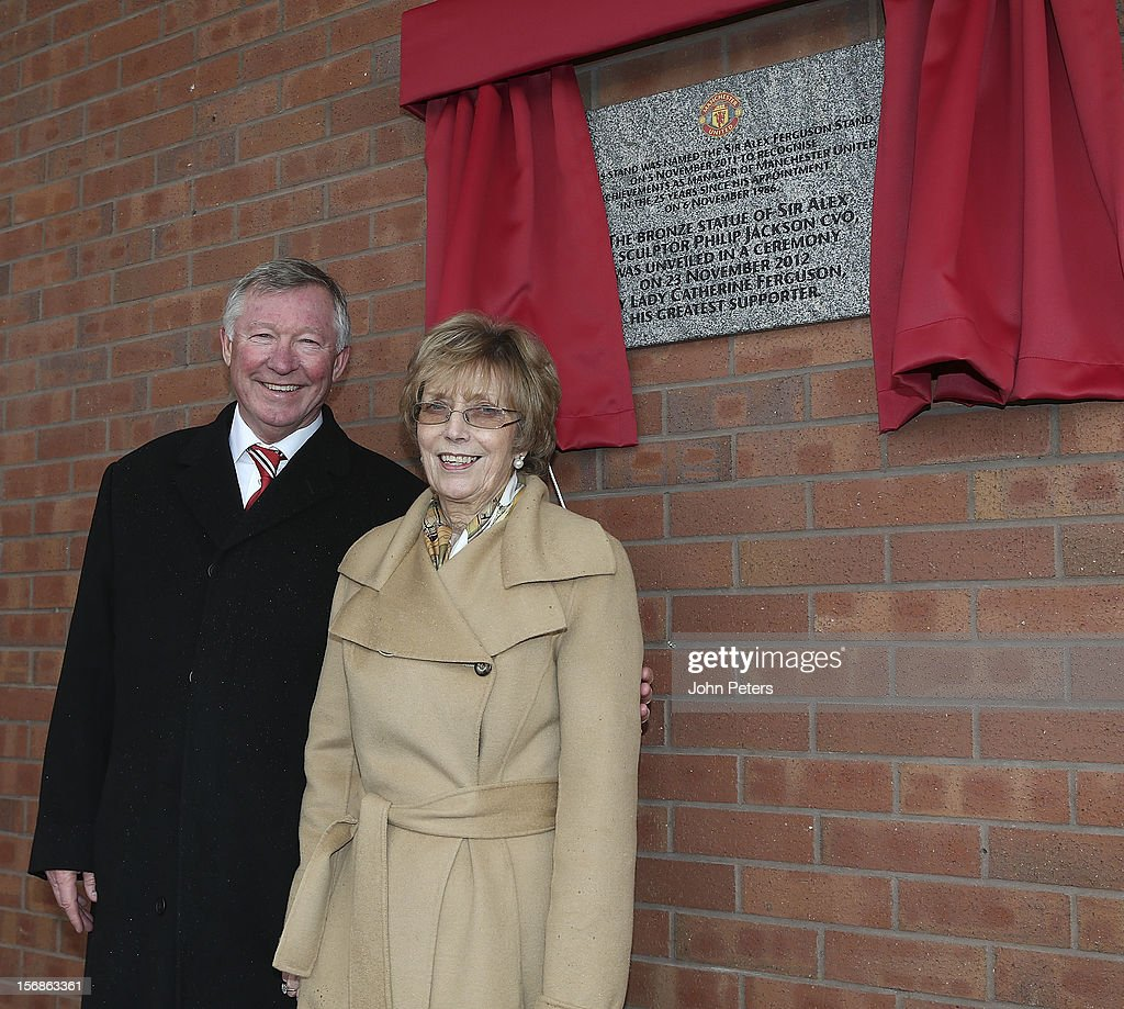 Sir <a gi-track='captionPersonalityLinkClicked' href=/galleries/search?phrase=Alex+Ferguson&family=editorial&specificpeople=203067 ng-click='$event.stopPropagation()'>Alex Ferguson</a> and Lady Cathy Ferguson pose after unveiling a plaque following the unveiling of a statue of Manager Sir <a gi-track='captionPersonalityLinkClicked' href=/galleries/search?phrase=Alex+Ferguson&family=editorial&specificpeople=203067 ng-click='$event.stopPropagation()'>Alex Ferguson</a> of Manchester United at Old Trafford on November 23, 2012 in Manchester, England.