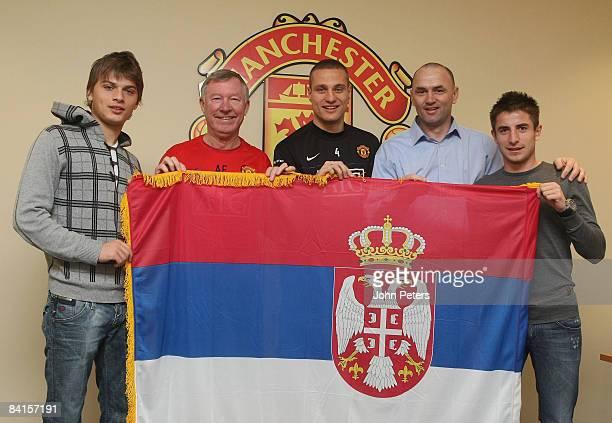 Sir Alex Ferguson and Nemanja Vidic of Manchester United pose with new Serbian signings Zoran Tosic and Adem Ljajic and club scout Budimir Vujacic at...