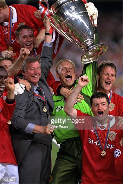 Sir Alex Ferguson and Peter Schmeichel along with Manchester United team mates celebrate as they lift the European Cup after the UEFA Champions...