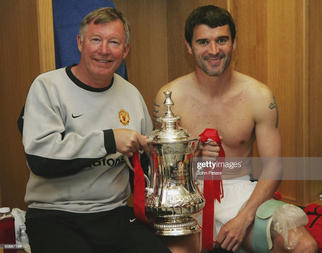 Sir <a gi-track='captionPersonalityLinkClicked' href=/galleries/search?phrase=Alex+Ferguson&family=editorial&specificpeople=203067 ng-click='$event.stopPropagation()'>Alex Ferguson</a> and Roy Keane of Manchester United celebrate with the FA Cup in the dressing room after winning the AXA FA Cup Final between Manchester United and Millwall at the Millennium Stadium on May 22, 2004 in Cardiff, Wales.