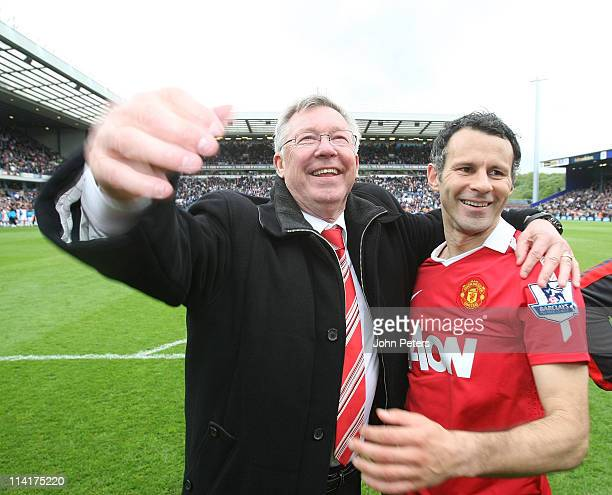 Sir Alex Ferguson and Ryan Giggs of Manchester United celebrate winning the Premier League title after the Barclays Premier League match between...