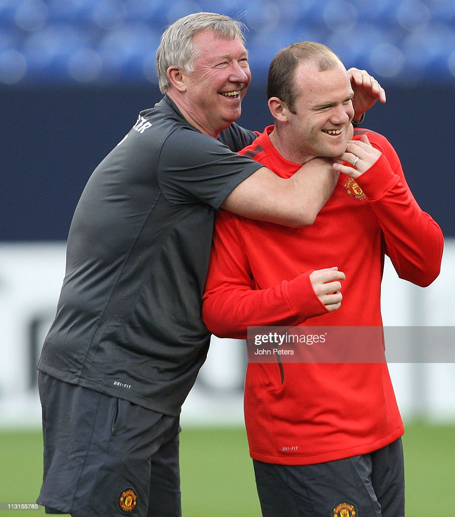 Sir Alex Ferguson (L) and Wayne Rooney of Manchester United in action during a first team training session ahead of their UEFA Champions League semi-final first leg match against Schalke at Veltins Arena on April 25, 2011 in Gelsenkirchen, Germany.