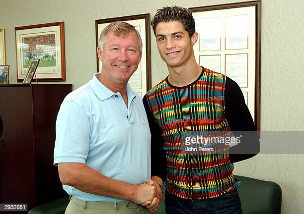 Sir Alex Ferguson greets Cristiano Ronaldo as the young Portugese player signs for Manchester united at the Carrington Training Ground Carrington on...