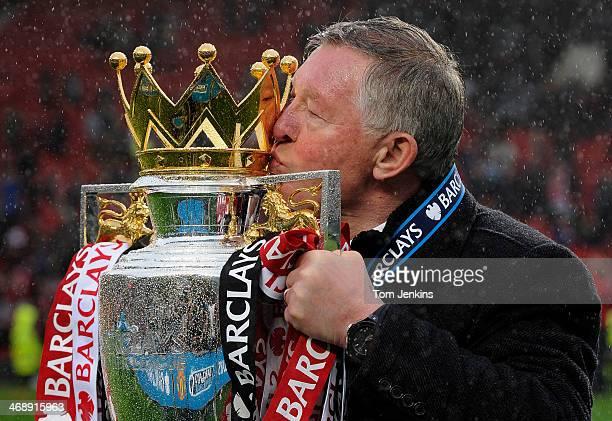 Sir Alex Ferguson kisses the Premier League trophy after the Manchester United versus Swansea City FA Premier League match the final home game for...