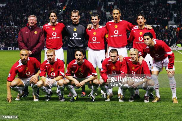 Sir Alex Ferguson lines up with the Manchester United team prior to the UEFA Champions League match between Manchester United and Olympique Lyon at...
